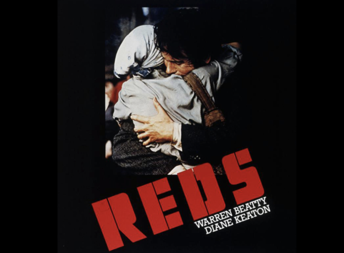 The original poster for 'Reds'.: a couple embracing with the words