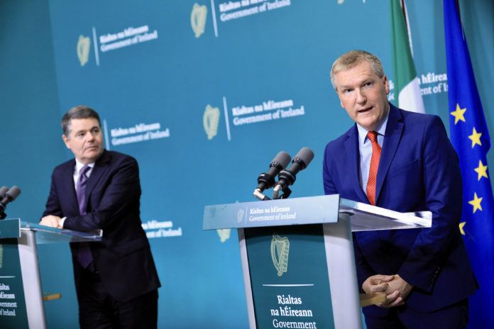 Minister Michael McGrath and Minister Paschal Donohoe speaking at a press conference