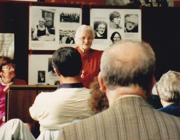 a photo of Nora Harkin speaking at the Desmond Greeves school.