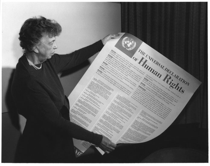 Eleanor Roosevelt holding poster of the Universal Declaration of Human Rights (in English), Lake Success, New York. November 1949.