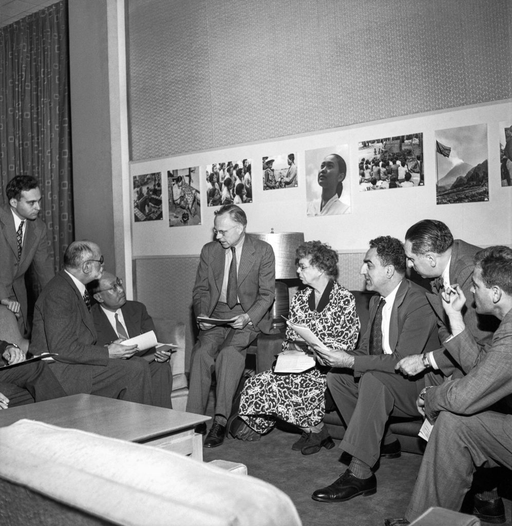 Professor Rene Cassin, France; Dr. P.C. Chang, Chinal; Quincy How, C.B.S. (Columbia Broadcasting Service), moderator; Mrs. Eleanor Roosevelt, U.S., Commission Chairman; Dr. Charles Malik, Lebanon, and Mr. E. Kelen of U.N. Radio Division. sit and talk.