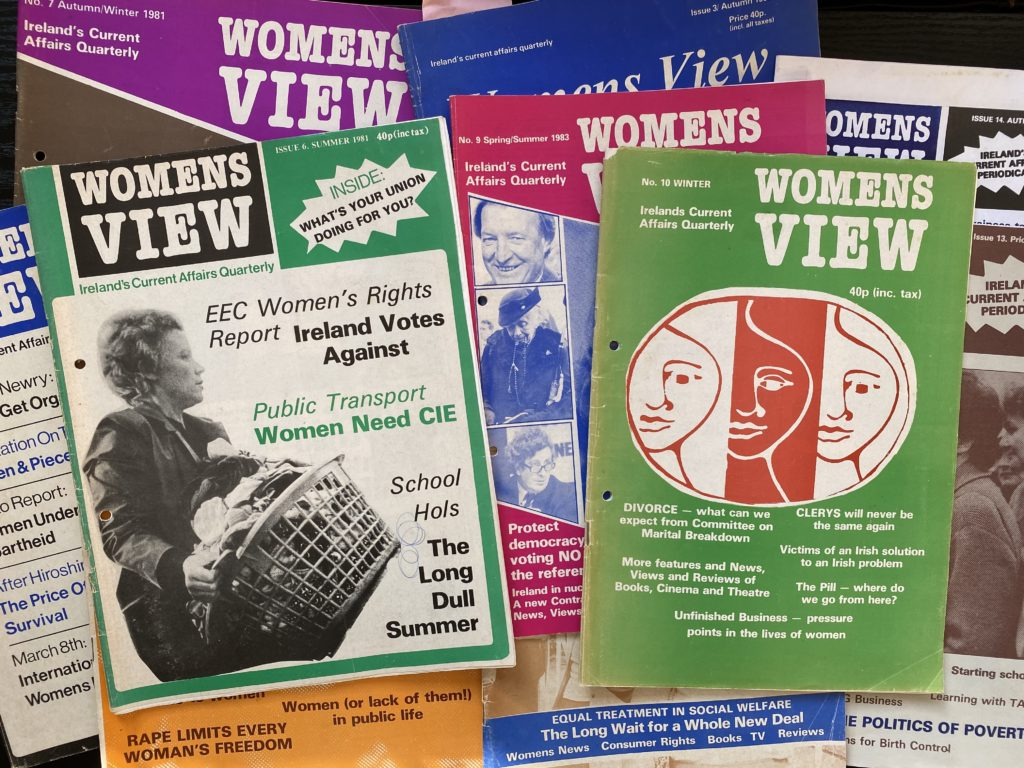 Several colourful copies of Women's View on top of each other.
