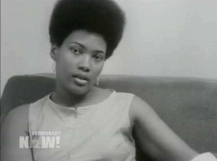 A still from a black and white interview of Akua Njeri in the 1960s.