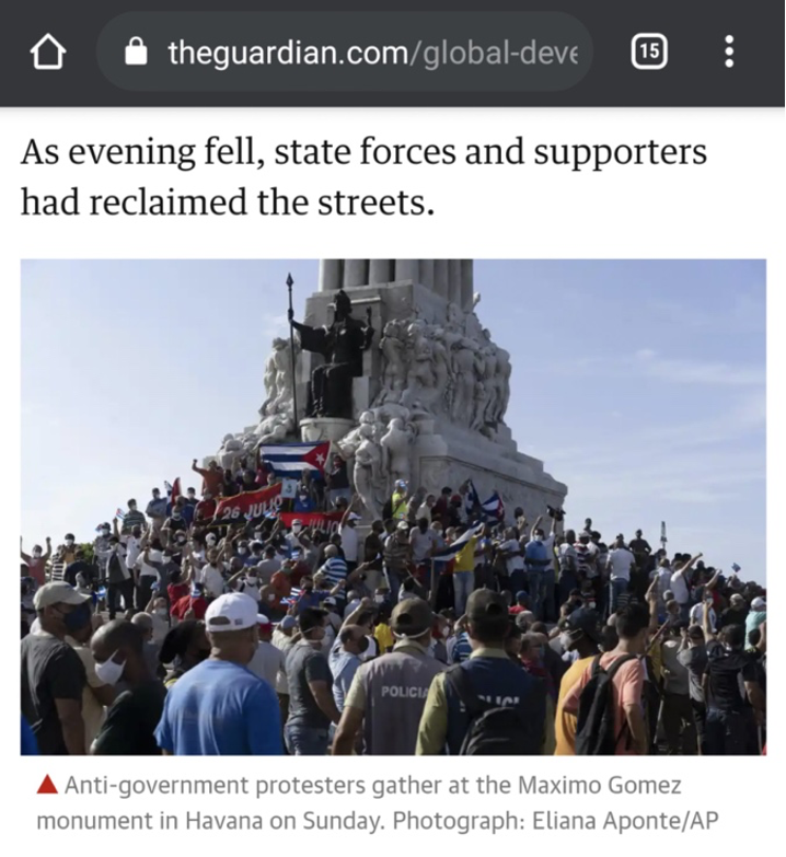 A screenshot of the Guardian website with a crowd gathered around a monument. The crowd is holding Cuban flags and the glad of the July 26 Movement